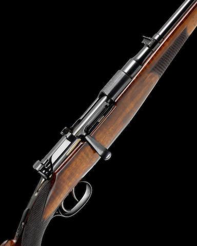 A 6.5mm 'M.1903' Mannlicher Schöenauer Stutzen by Steyr, no. 2859/1961 Retailed by F. Beesley In its canvas case with some accessories