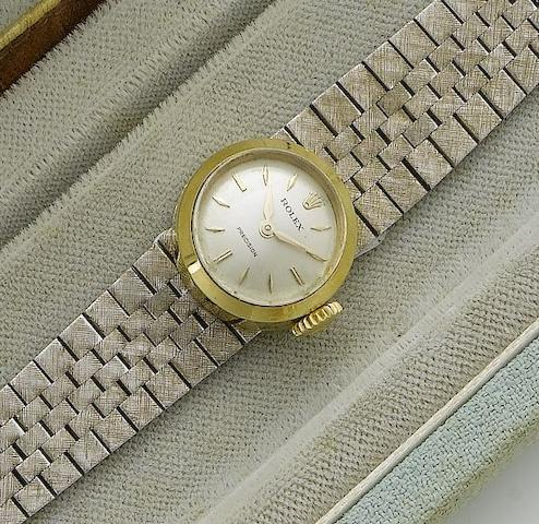 Rolex. A lady's 18ct gold wristwatch with fitted box and interchangeable straps Chameleon, 1950's