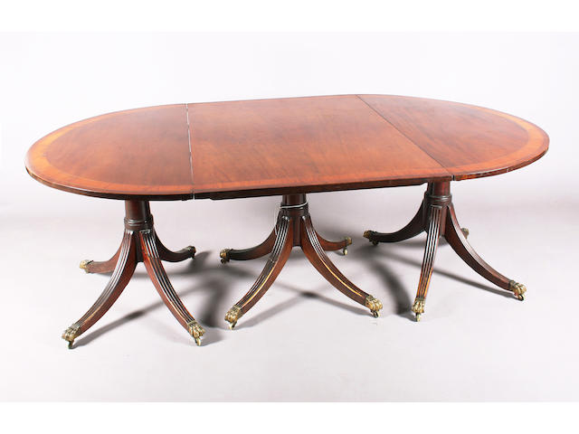 A Regency style mahogany 'D' end triple pillar dining table