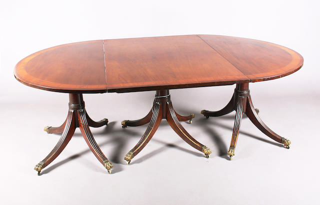 A George III style, mahogany triple pedestal 'D' end dining table,