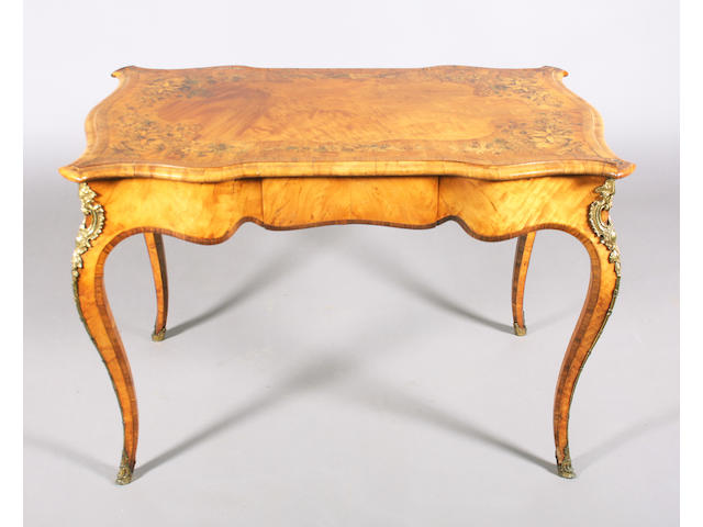 An early Victorian, Louis XV style, olivewood, kingwood crossbanded and brass mounted bureau plat