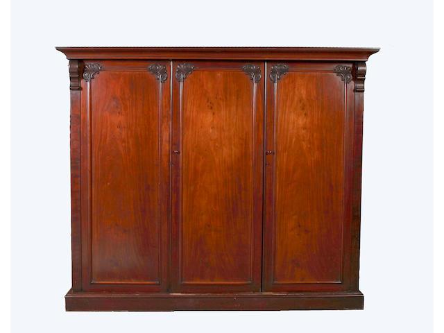 An early Victorian mahogany triple wardrobe,