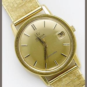 Omega. An 18ct gold automatic centre seconds calendar bracelet watch  Seamaster, 1970's