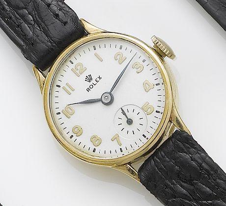 Rolex. A lady's 9ct gold wristwatch Birmingham Hallmark for 1948