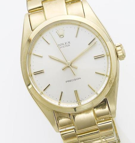 Rolex. A 14ct gold centre seconds wristwatchOyster, sold November 25th 1988