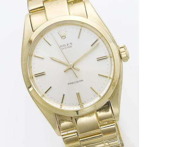 Rolex. A 14ct gold centre seconds wristwatch Oyster, sold November 25th 1988