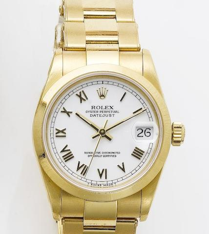 Rolex. An 18ct gold mid size centre seconds calendar bracelet watch with fitted boxDatejust, 1995, sold in 2002