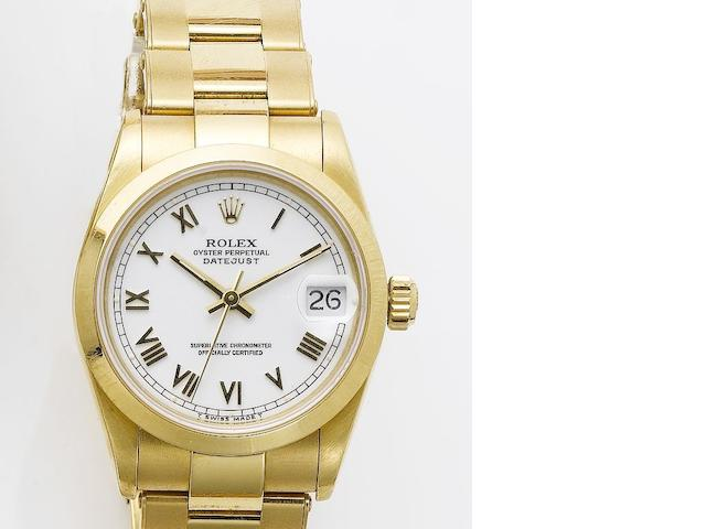 Rolex. An 18ct gold mid size centre seconds calendar bracelet watch with fitted box Datejust, 1995, sold in 2002