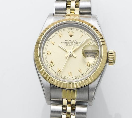 Rolex. A lady's stainless steel and gold centre seconds calendar bracelet watch with box and papers Oyster Date, sold in 1984