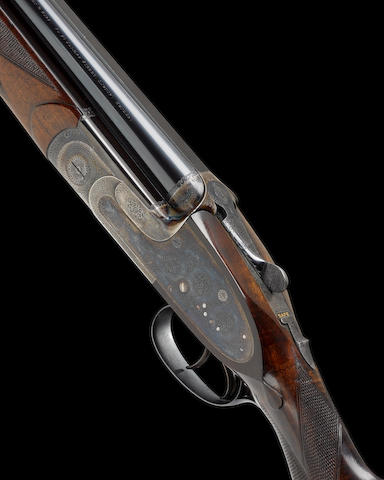 A fine 12-bore (2¾in) over-and-under sidelock ejector pigeon gun by J. Woodward, no. 6729 In a J. Woodward leather case with canvas cover and some accessories