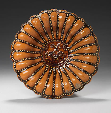 A Staffordshire Slipware Sun Face dish Late 17th or early 18th century.
