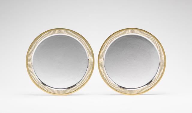 STUART DEVLIN: A pair of silver and silver-gilt circular salvers, London 1973,