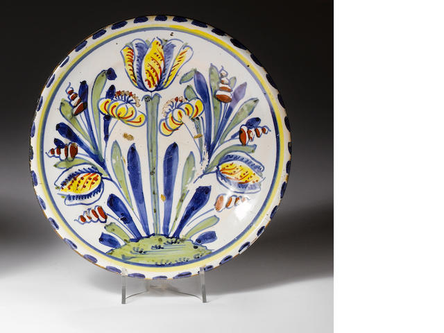 An English delft tulip charger  Circa 1695-1700.