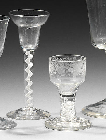 A pan-topped opaque-twist wine glass and an engraved opaque-twist firing glass Circa 1765.