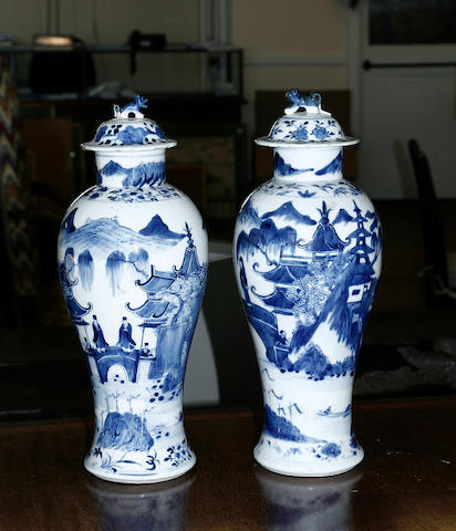A pair of Chinese blue and white baluster vases and associated covers Kangxi four-character marks, 19th century,