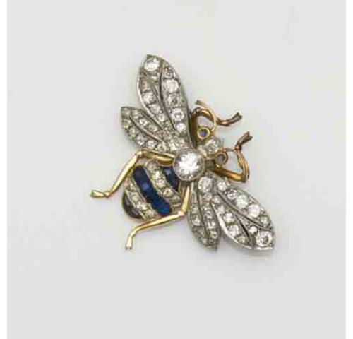 A diamond and sapphire bee brooch