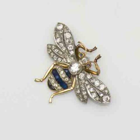 A diamond and sapphire bee brooch
