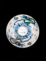 A rare pair of wucai 'dragon' bowls and covers  Yongzheng six-character marks and of the period