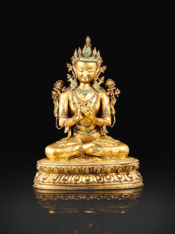 A magnificent and extremely rare large gilt-bronze figure of Manjushri 14th/15th century