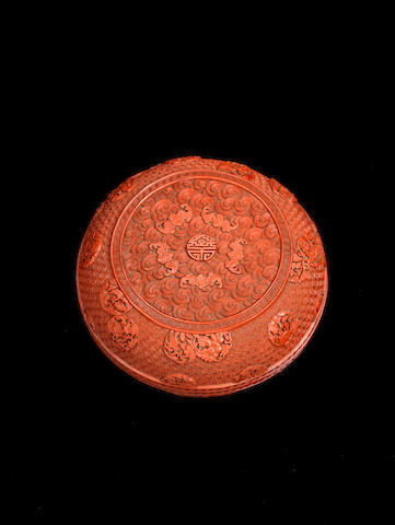 A carved cinnabar lacquer circular box and cover Qianlong