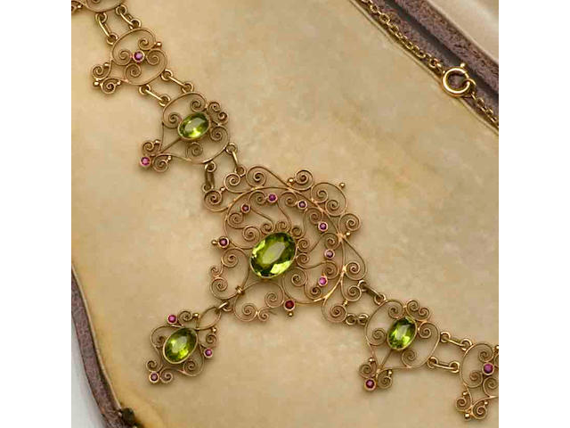 An Edwardian peridot and ruby set necklace