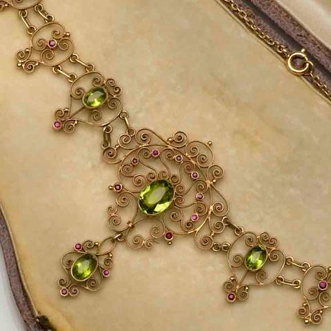 An Edwardian peridot and ruby set necklace