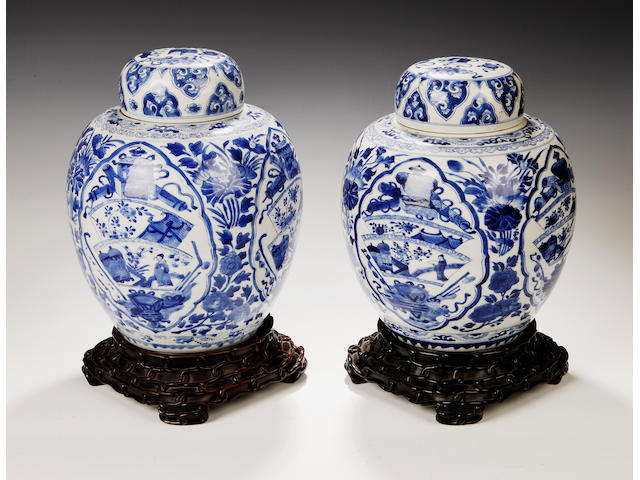 A near pair of large oviform jars and covers 18th century