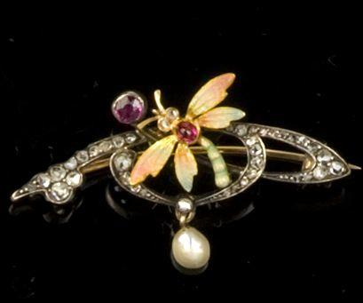 An Art Nouveau enamel and gem set dragonfly brooch