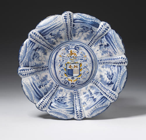 Early London delft moulded dish with the arms of Markham, c.1650