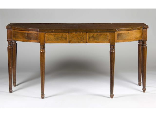 A Regency mahogany crossbanded breakfront serving table