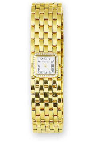 A lady's gold and diamond-set wristwatch, by Cartier