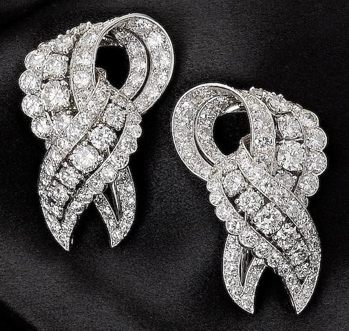 A pair of diamond clip brooches, by Cartier,