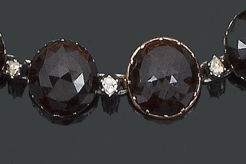 A 19th century garnet and diamond rivière necklace