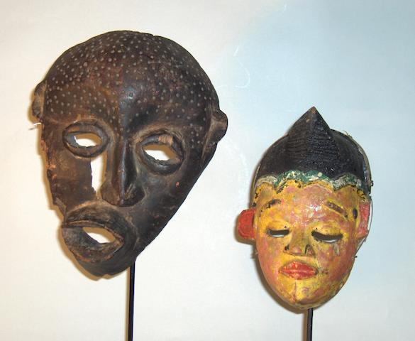 An Ibibio mask and a Congo sickness mask, 21 and 28cm high respectively 2