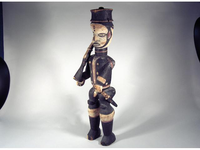 An Ibibio colonial figure, Nigeria 69cm high (repairs)