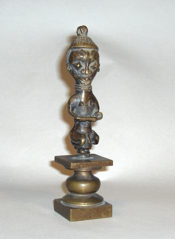 A Yoruba Ogboni society bronze staff, Nigeria 13cm high
