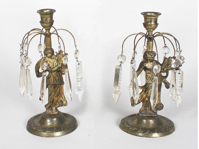 A pair of 19th century brass figural candlesticks