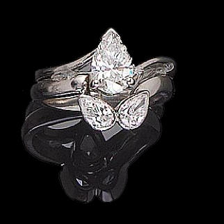 A diamond single-stone ring and a diamond two-stone band ring