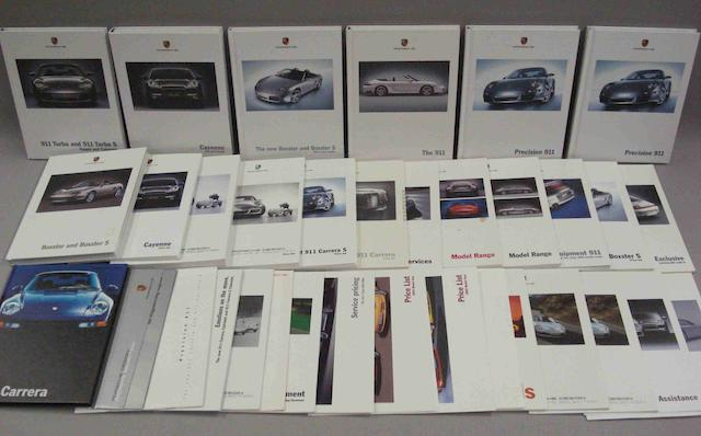 A lot of modern Porsche sales brochures,