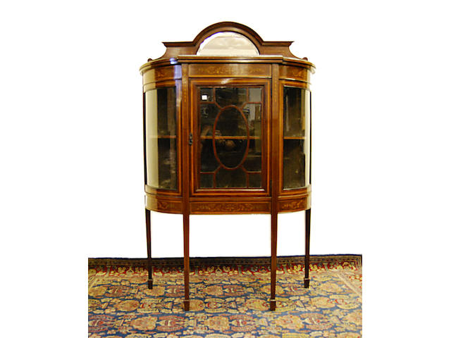 An Edwardian mahogany and inlaid dwarf display cabinet