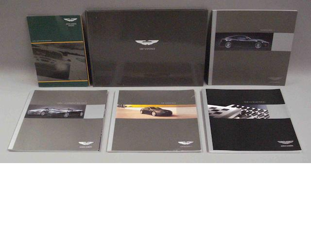 A lot of modern Aston Martin sales brochures,