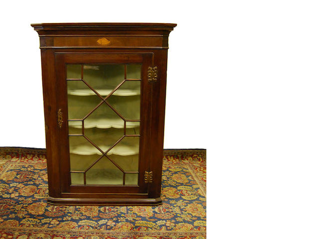 A George III mahogany and inlaid standing corner cupboard