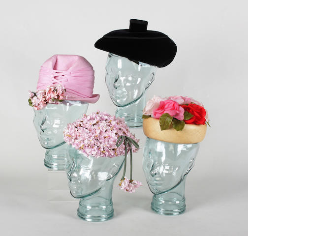 A large collection of boxed 20th century hats, to include a pink floral Philip Somerville beret