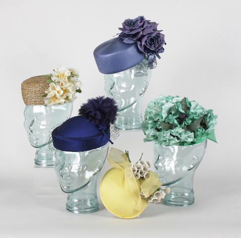 A large collection of 20th century boxed hats to include a blue straw pillbox hat by Graham Smith