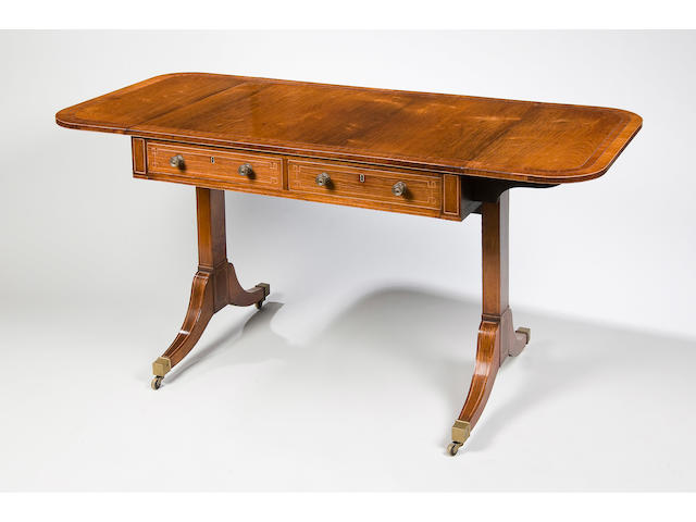 A Regency rosewood amd mahogany crossbanded sofa table