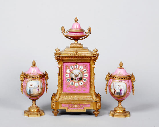 A late 19th century French clock and garniture