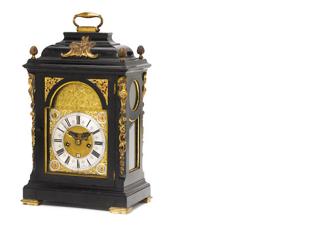 A late 17th century bracket clock movement and dial now contained in a mid 18th century case The dia