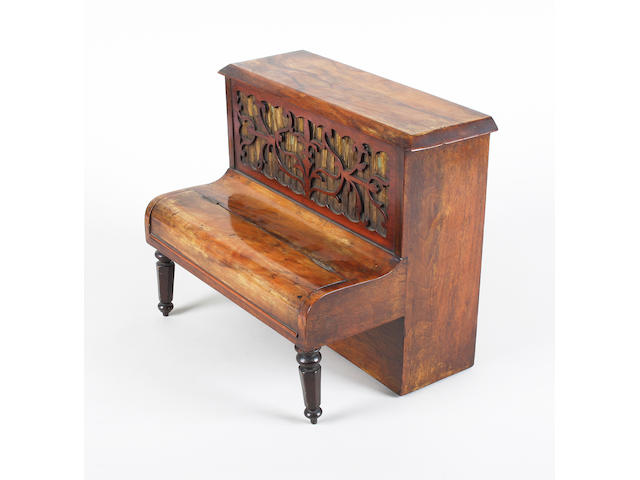 An unusual mid-19th century walnut writing and sewing box in the form of an upright piano