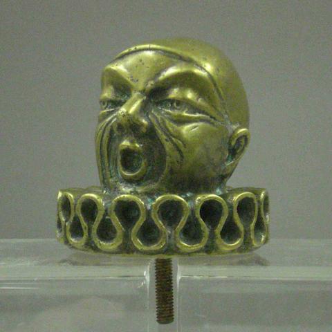 A Pierot bronze car mascot,
