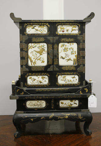 A small gilt and black lacquer cabinet 19th century